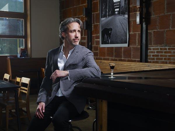 Jamie Thomas et al. sitting at a table