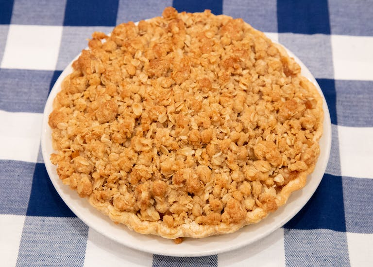 an apple crumb pie on a table at Blue Smoke