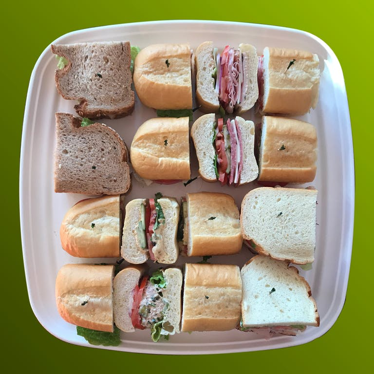 a white plate topped with sandwiches