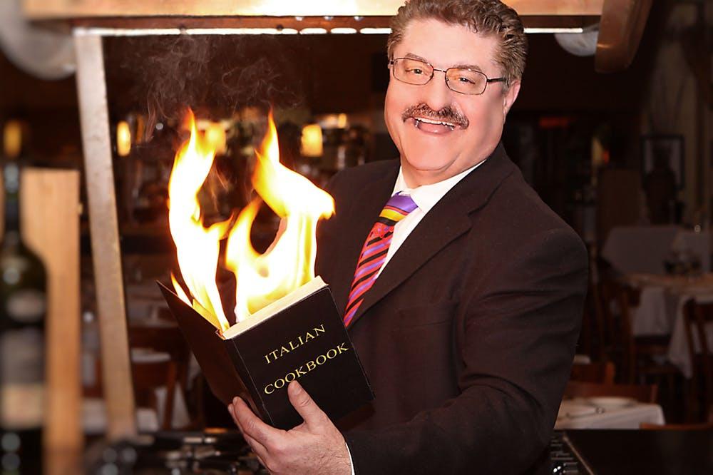 Silviu Prigoană standing in front of a fireplace