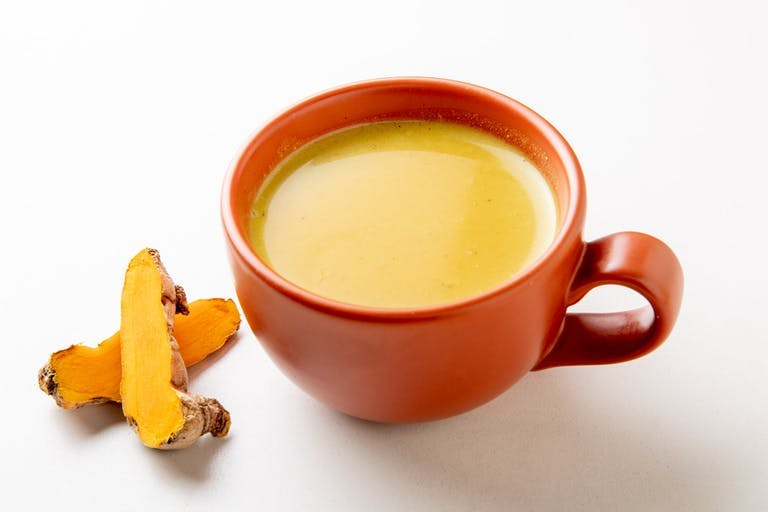 a cup of coffee and a glass of orange juice