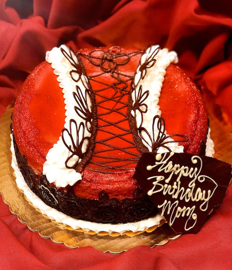 a red and white cake on a plate