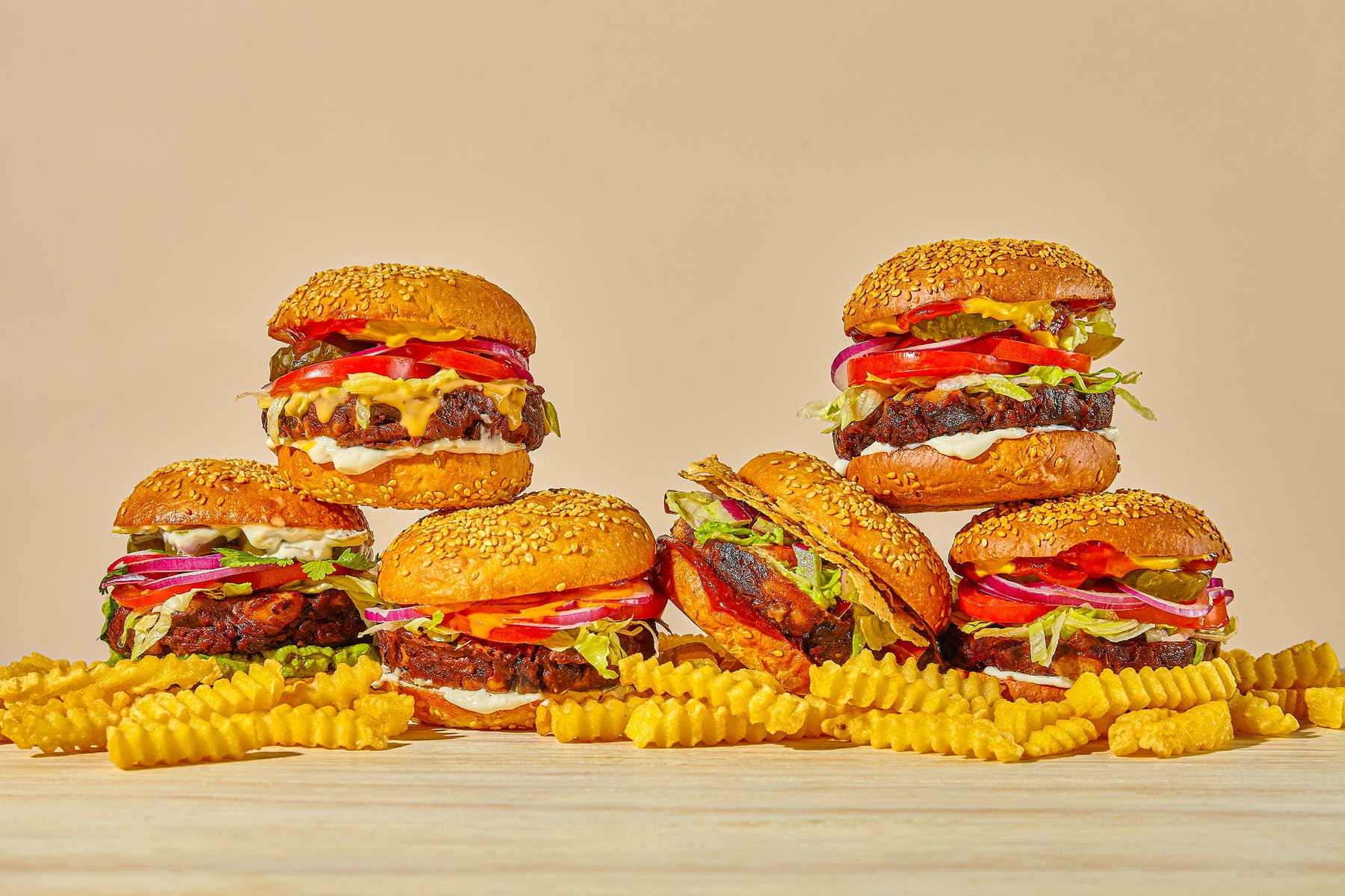 a pile of burgers and fries