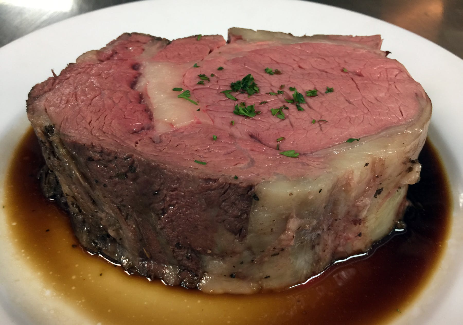 a piece of prime rib on a plate