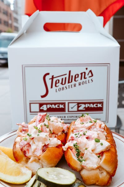a plate of fresh Maine lobster rolls