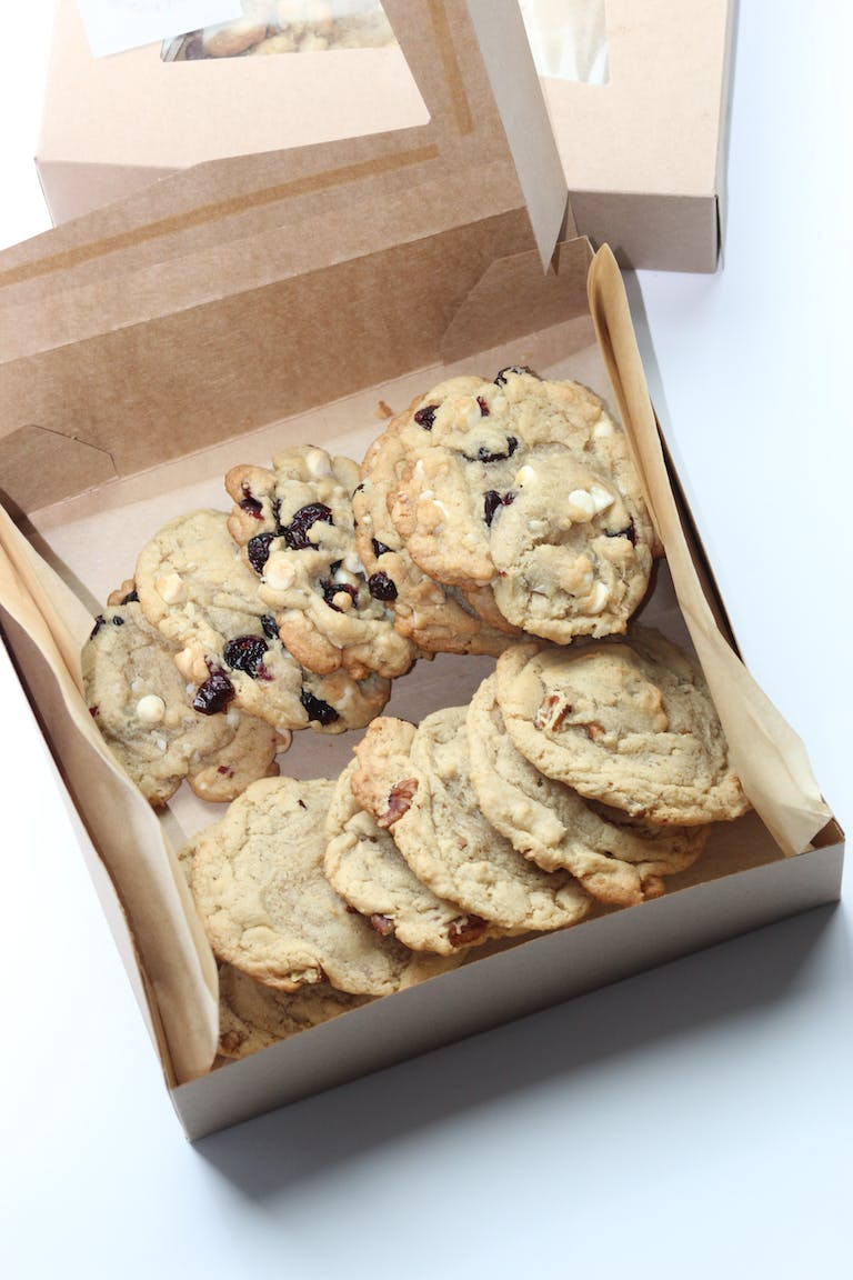 a box filled with different types of cookies