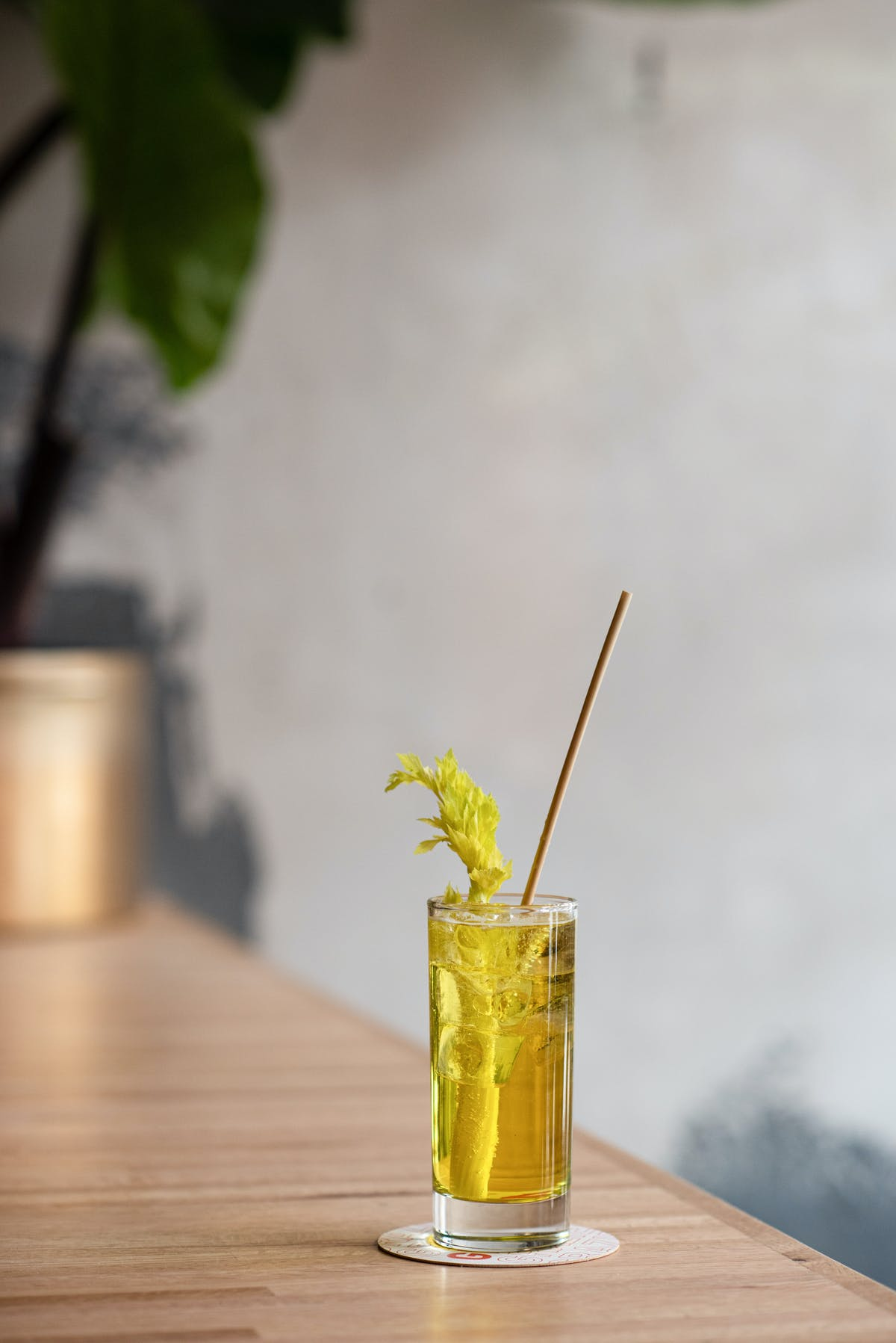 a close up of a drink on a bar