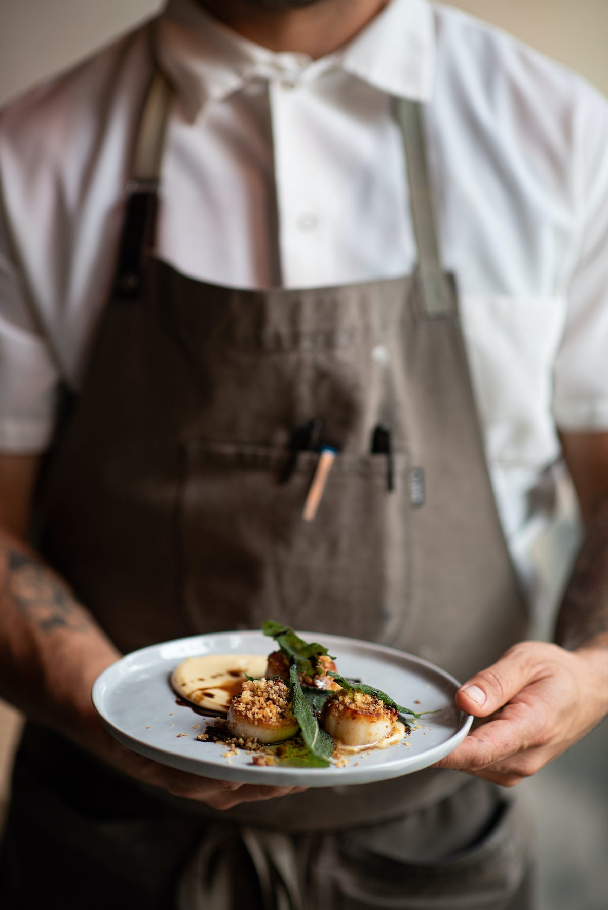 a chef holding a plate of food