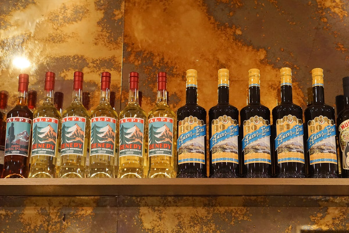 a close up of Italian amaro bottles on display