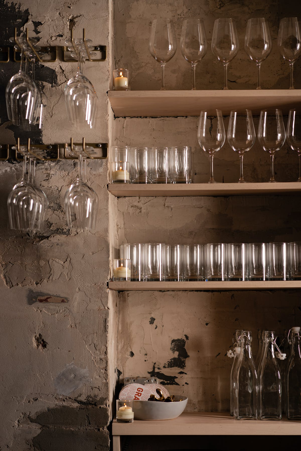 a store shelf filled with wine glasses
