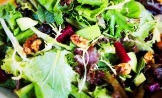 a close up of a bowl of salad