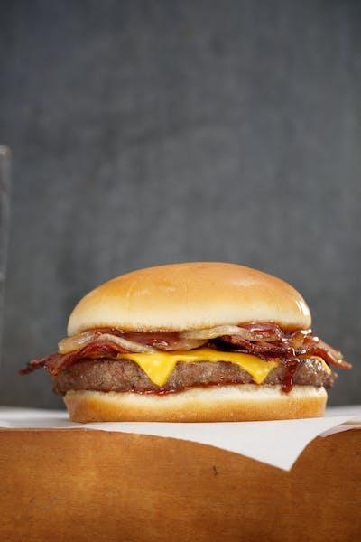 a close up of a hamburger on top a napkin