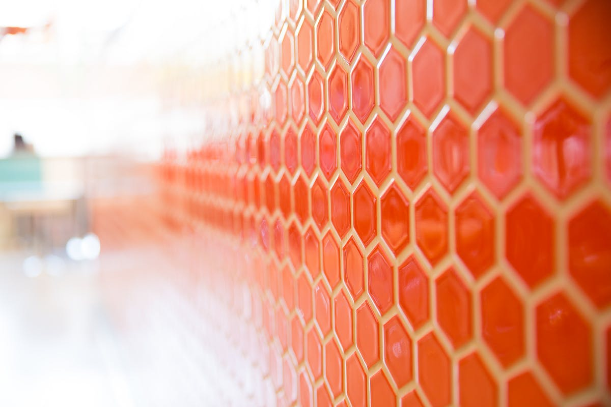 a close up of a honeycomb painted wall