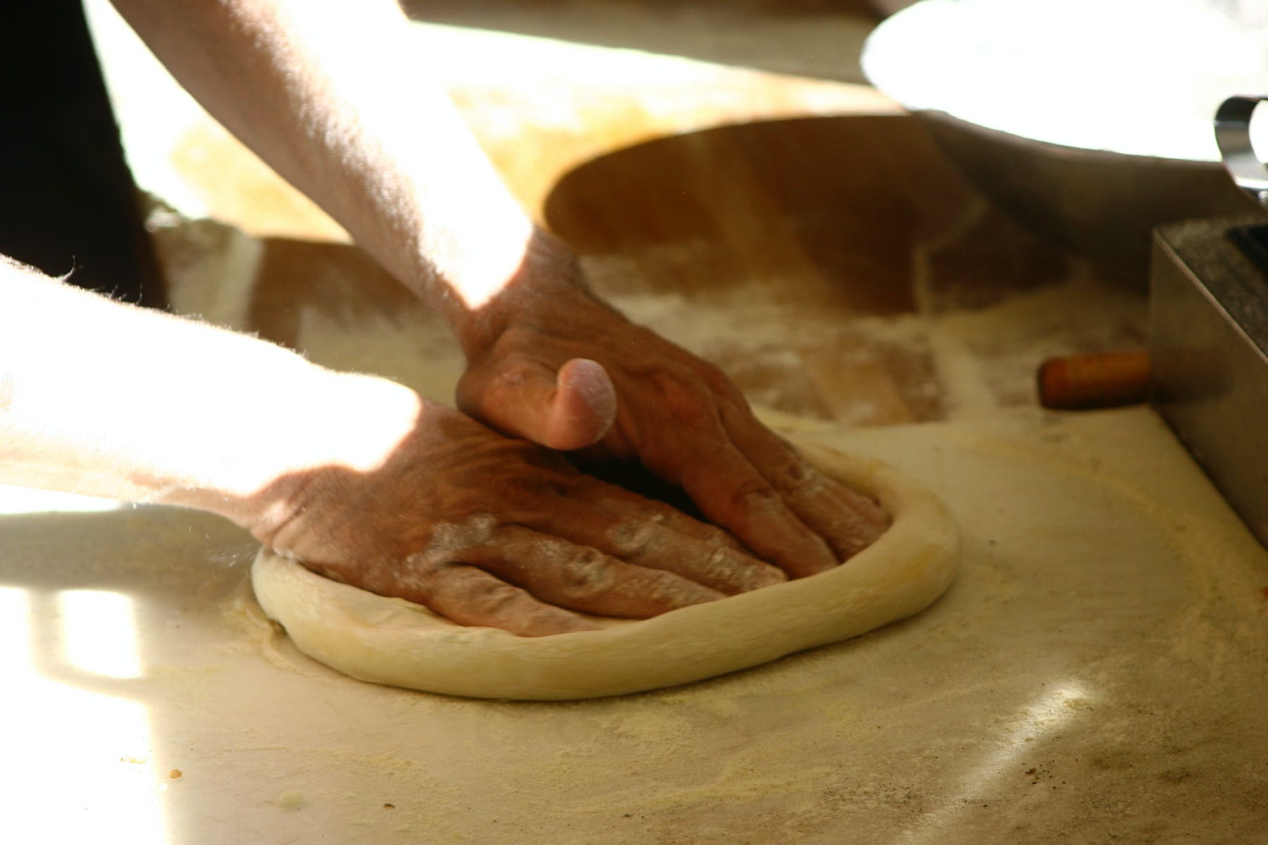 hands preparing a dough
