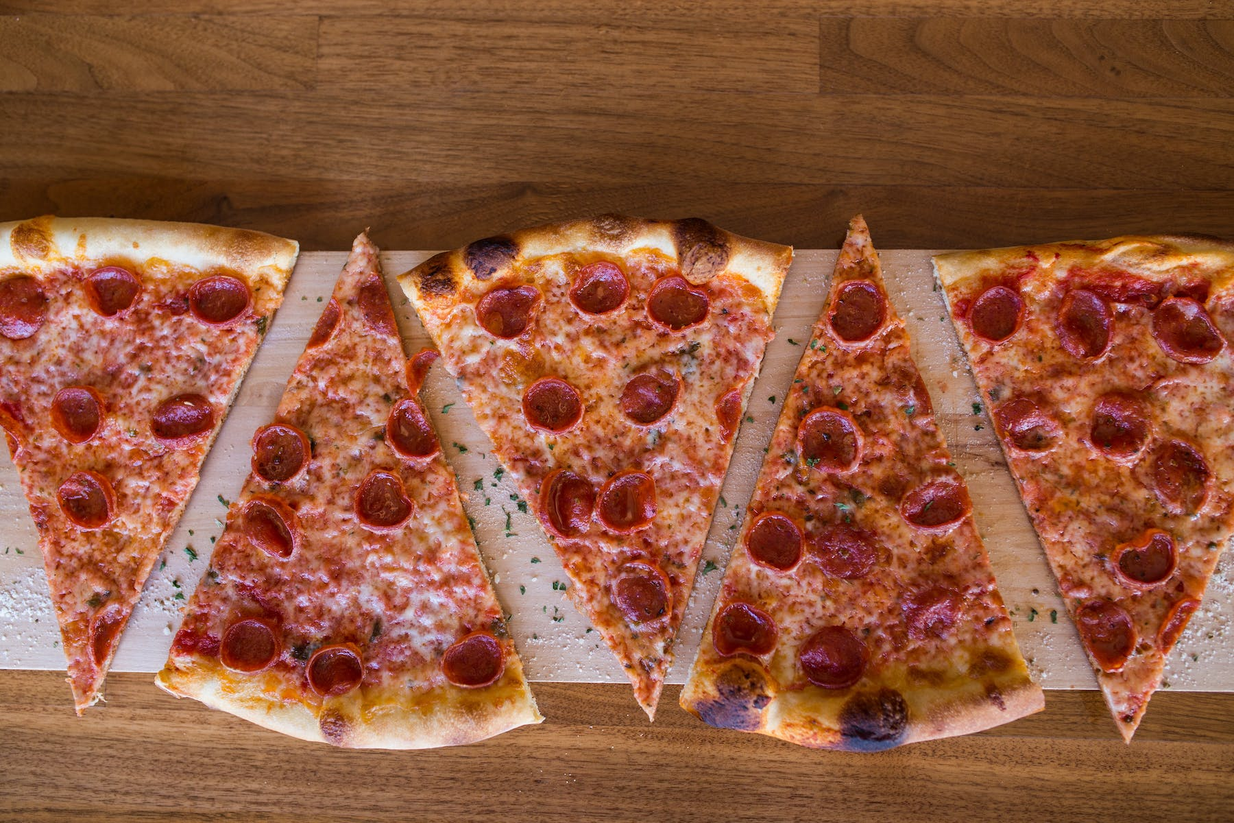 slices of pepperoni pizza on a table