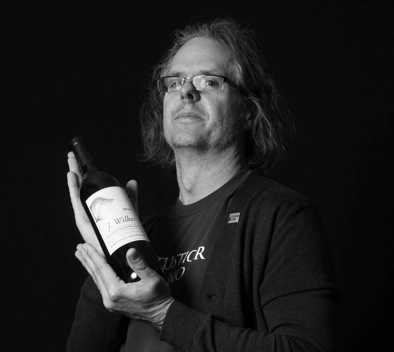 Doug Morrow holding a wine glass