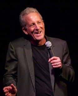 Bobby Slayton wearing a suit and tie