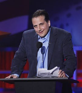 Nick DiPaolo in a suit and tie
