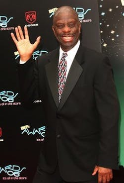 Jimmie Walker wearing a suit and tie