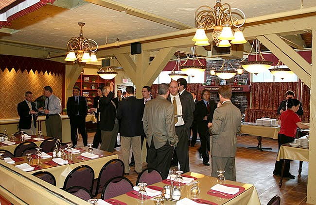 a group of people standing around a table