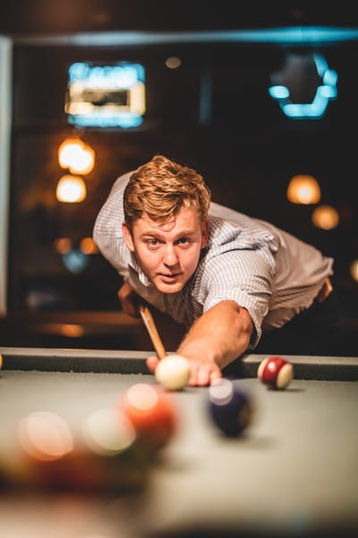 a person playing pool