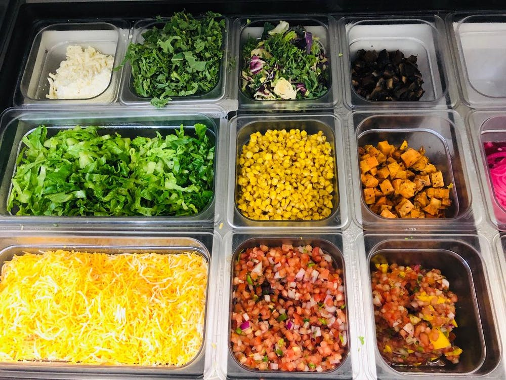 a plastic container filled with different types of food