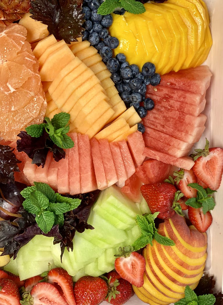 a plate of fruit and vegetable salad