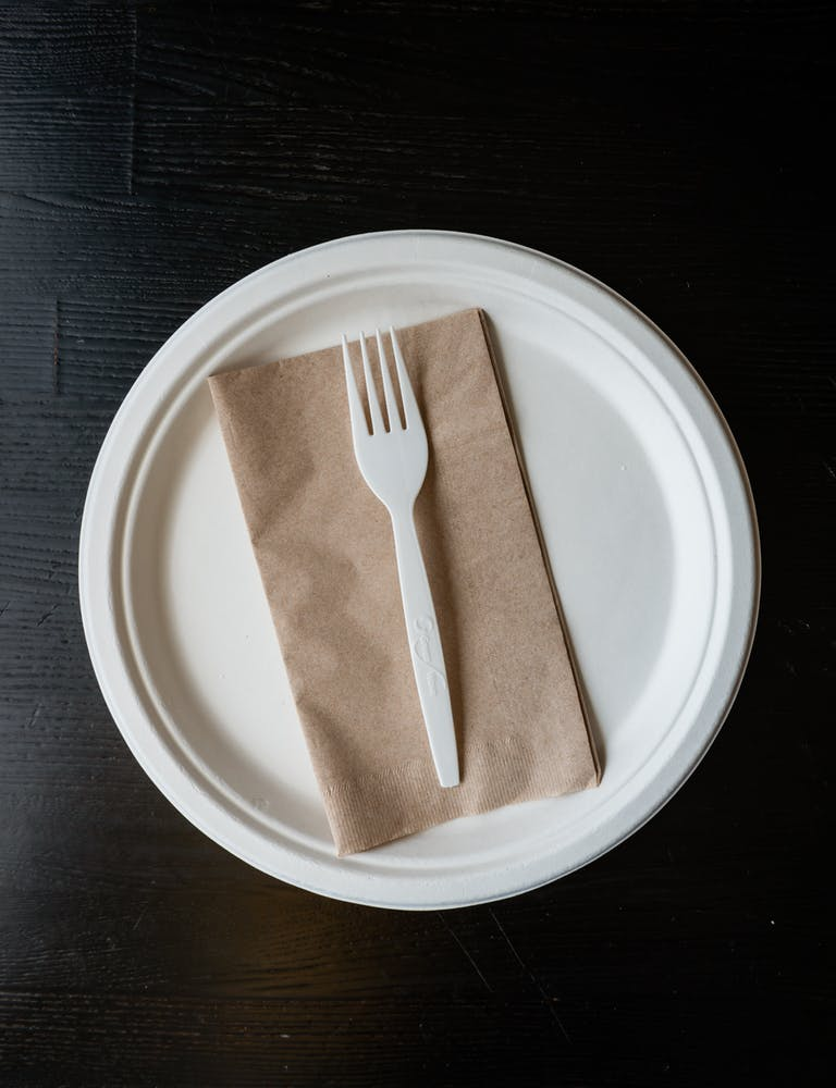 a plate with napkin and fork