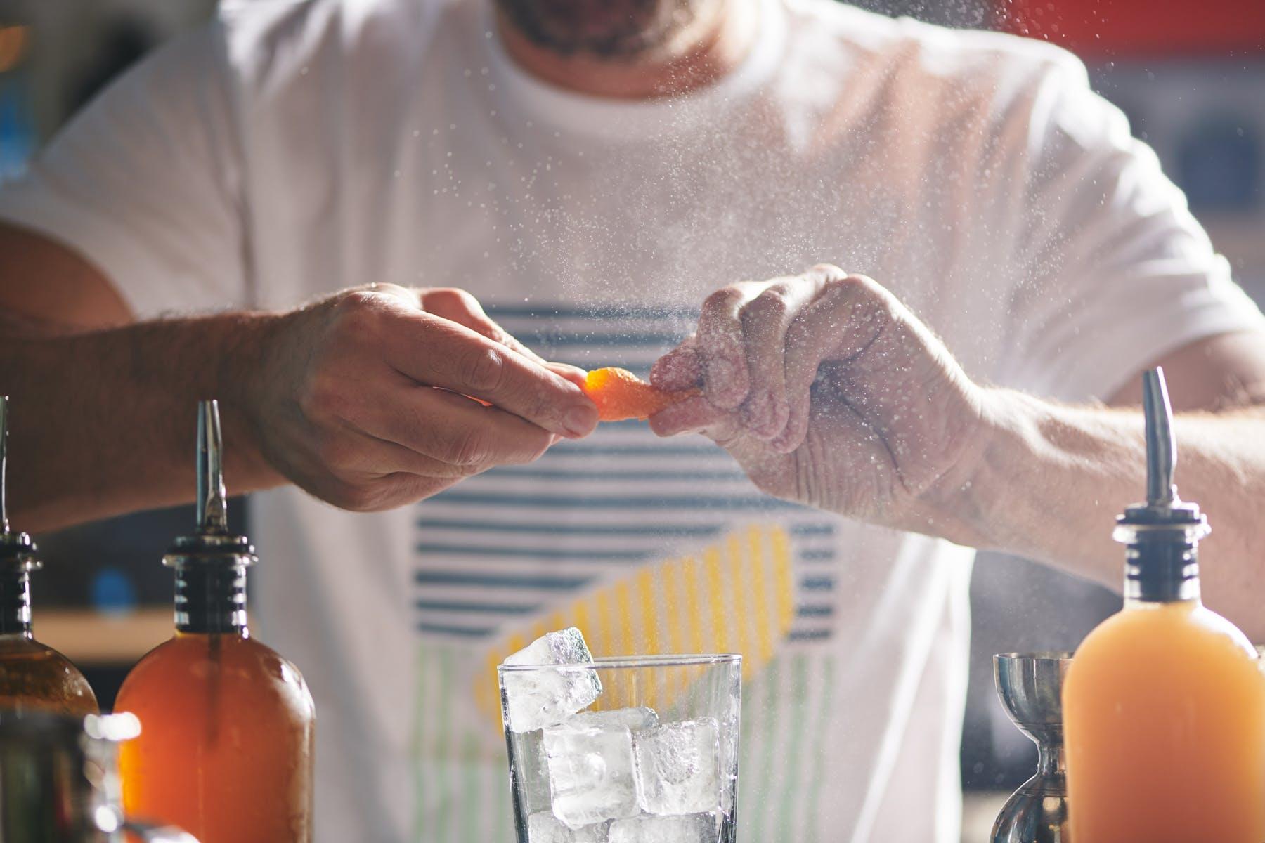 a man holding a glass of orange juice