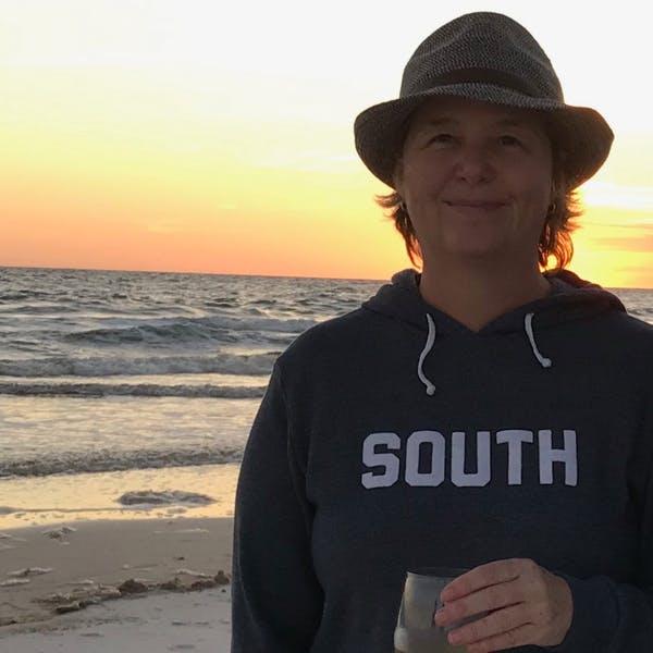 Ross Jones standing on a beach