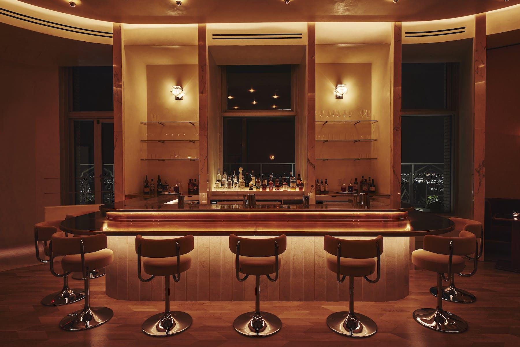 barroom with stool at night