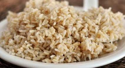 a close up of a bowl of rice on a plate