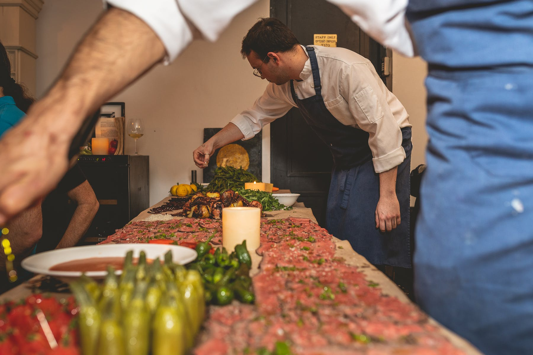 Chefs preparing and serving food for a private event