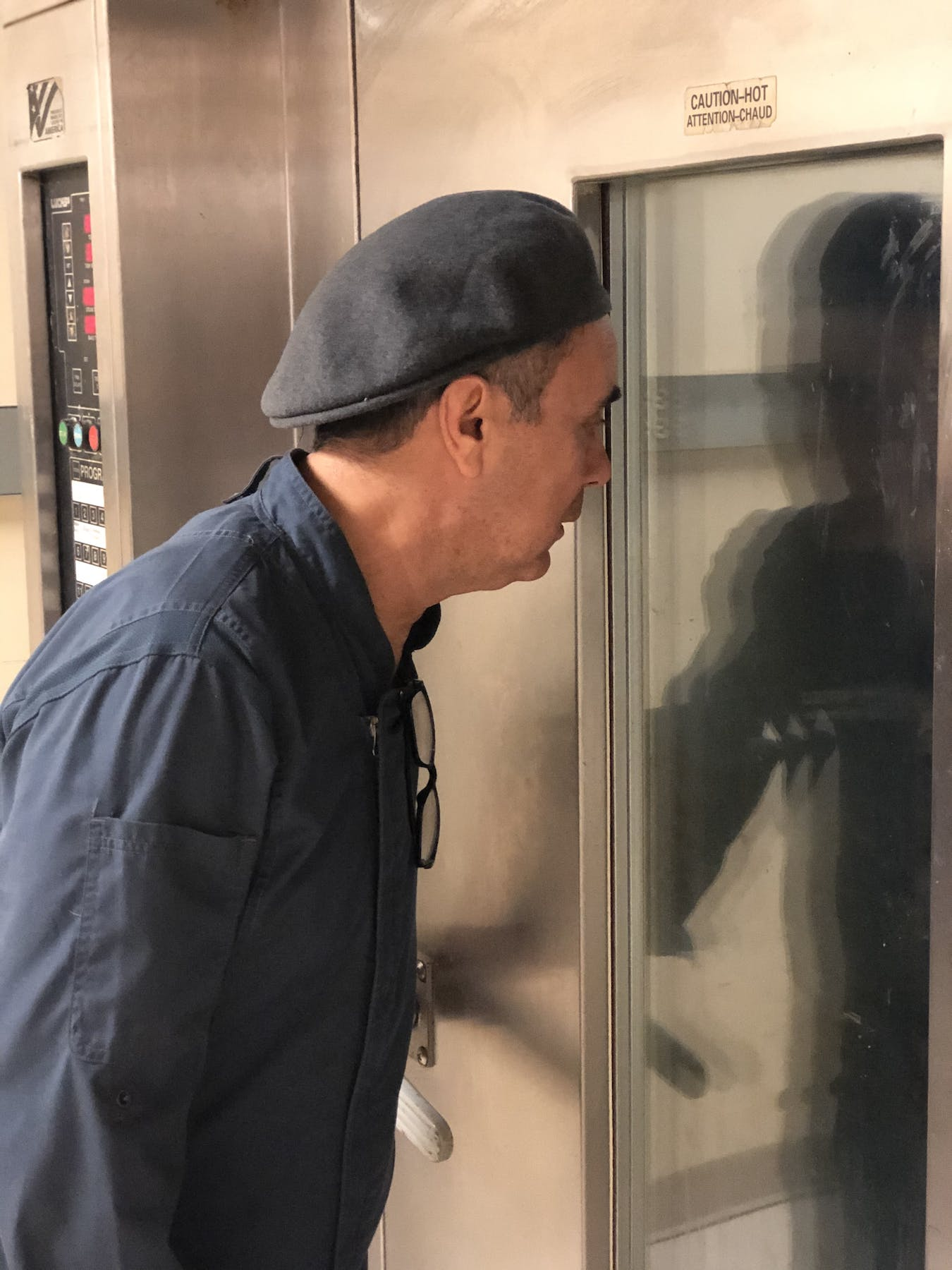 a man looking at a fridge door