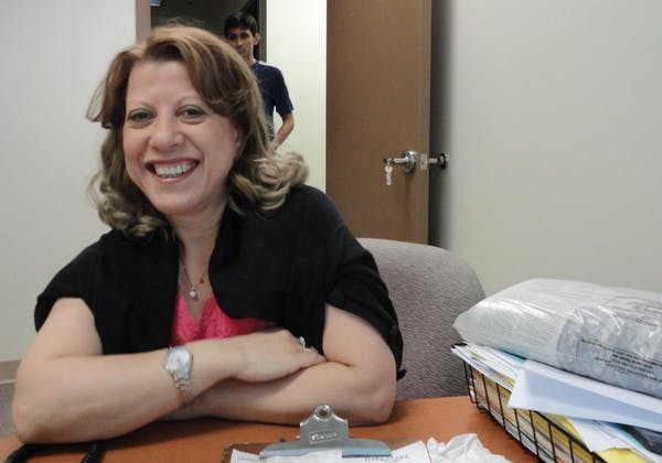 Aicha Benabbes smiling at the camera