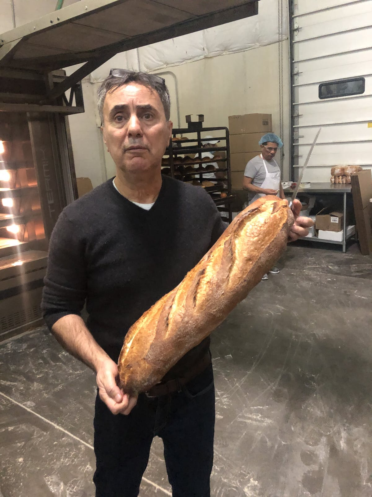 a man holding a baguette