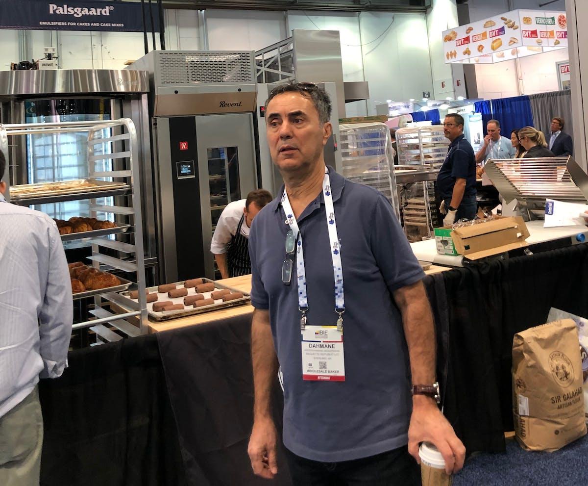 a man inside a bakery's kitchen