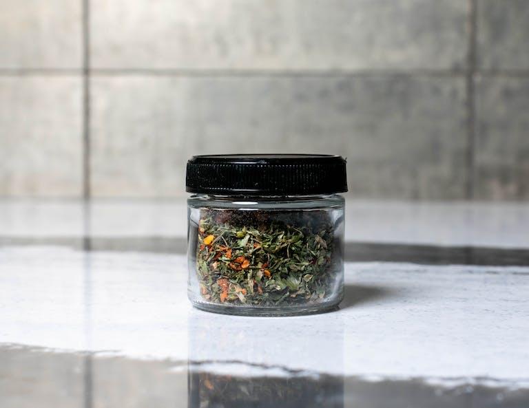 a glass mug on a counter