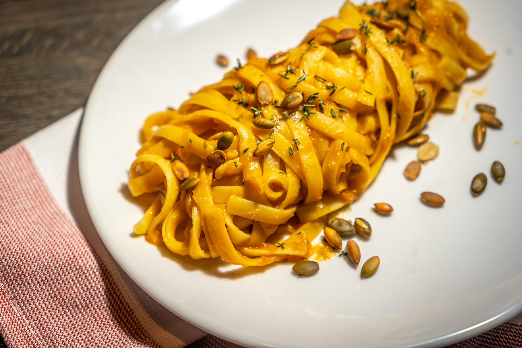 a white plate topped with pasta and cheese