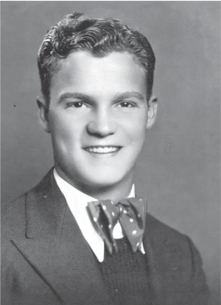 a vintage photo of a young man wearing a suit and tie