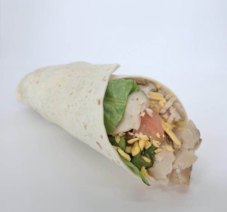 a half eaten sandwich on a plate