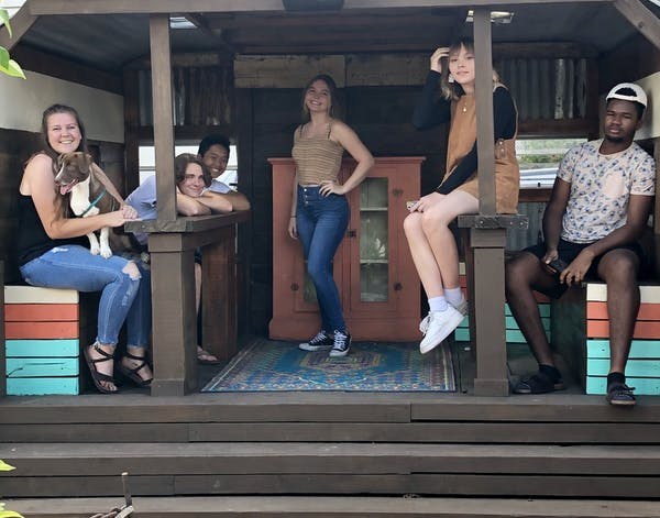 a group of people sitting on a bench