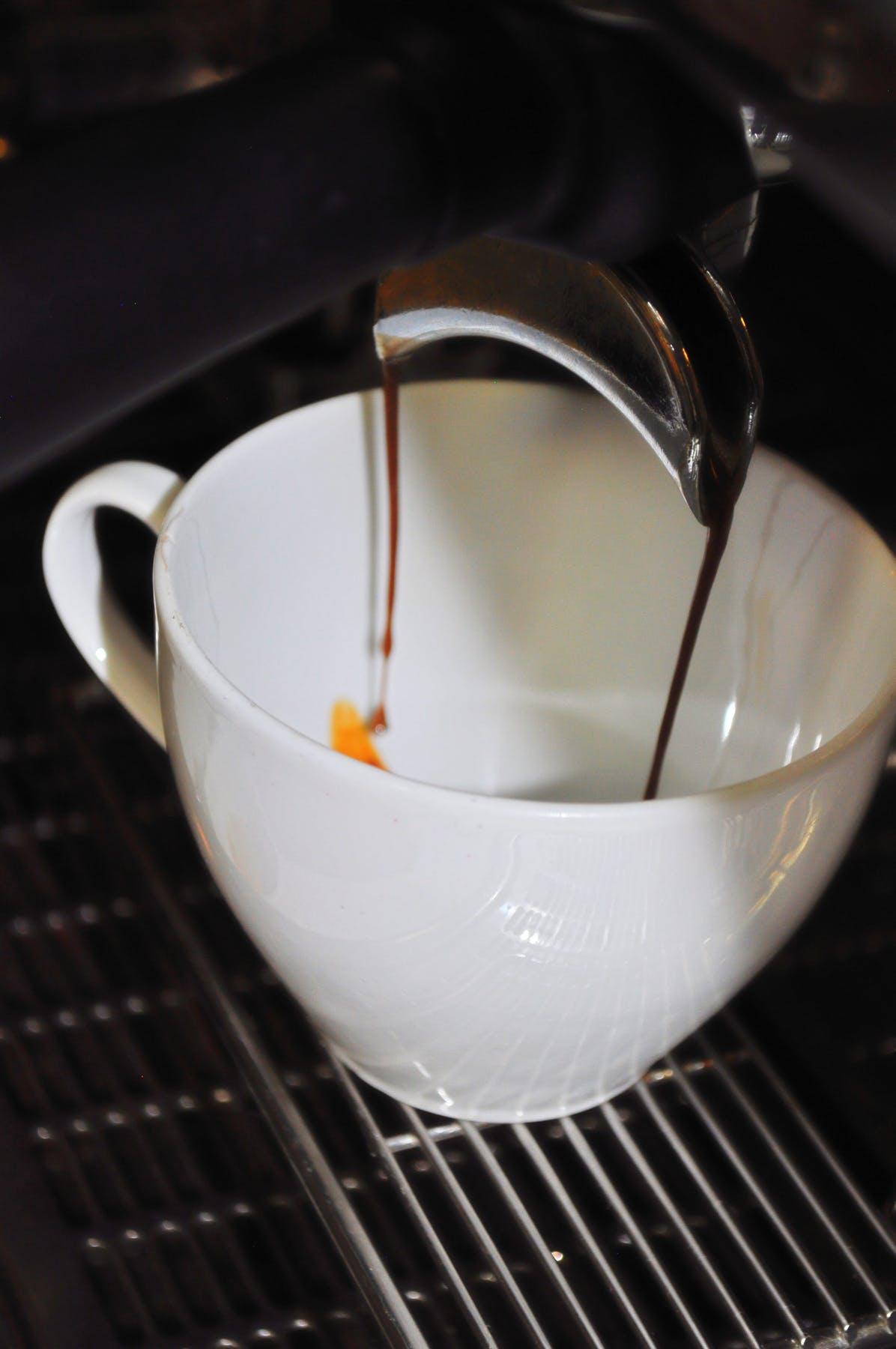 a close view of espresso dripping