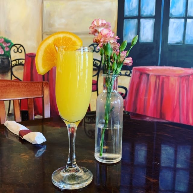 a mimosa on a table