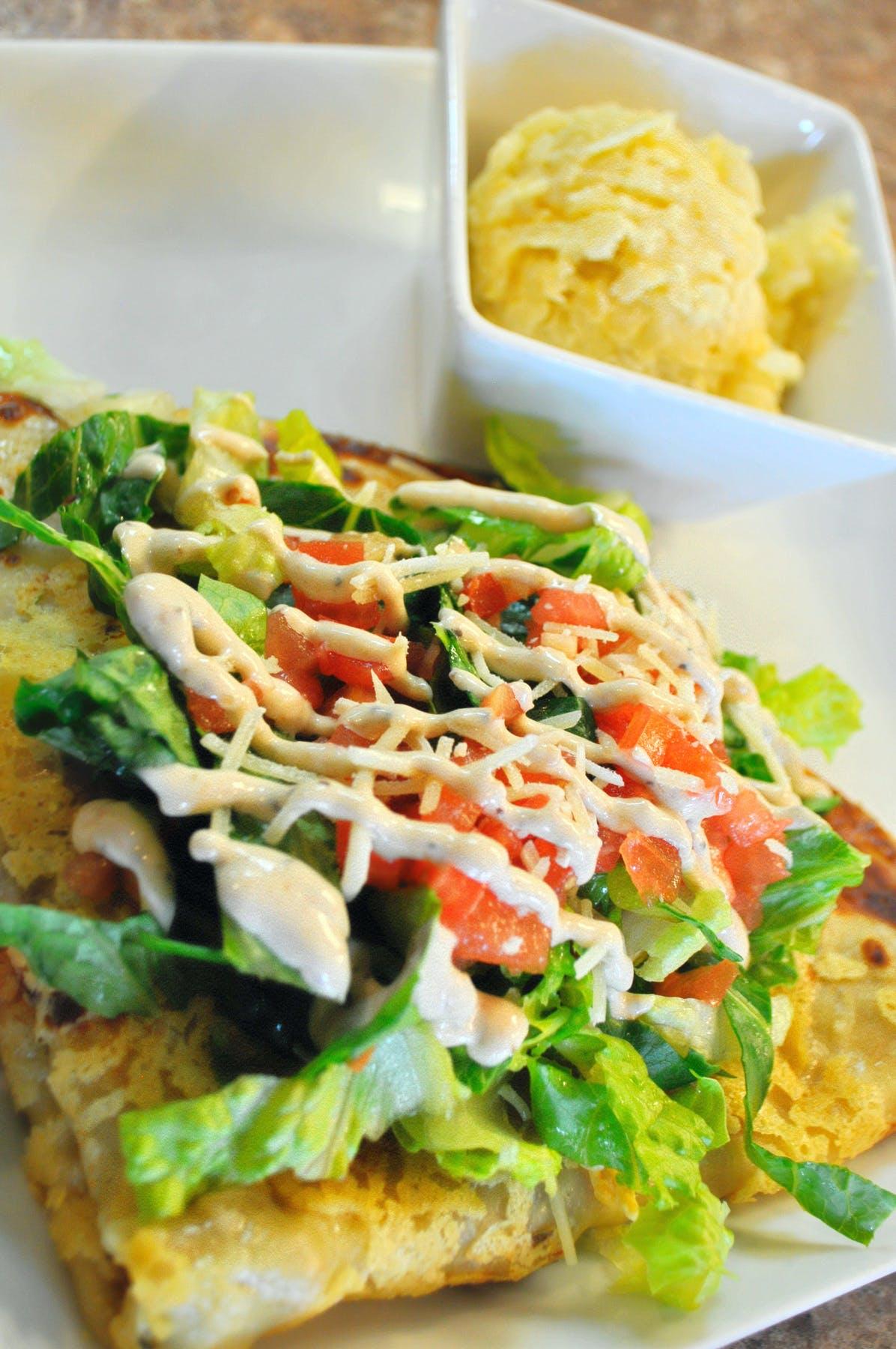 a savory crepe and potatoes on a plate