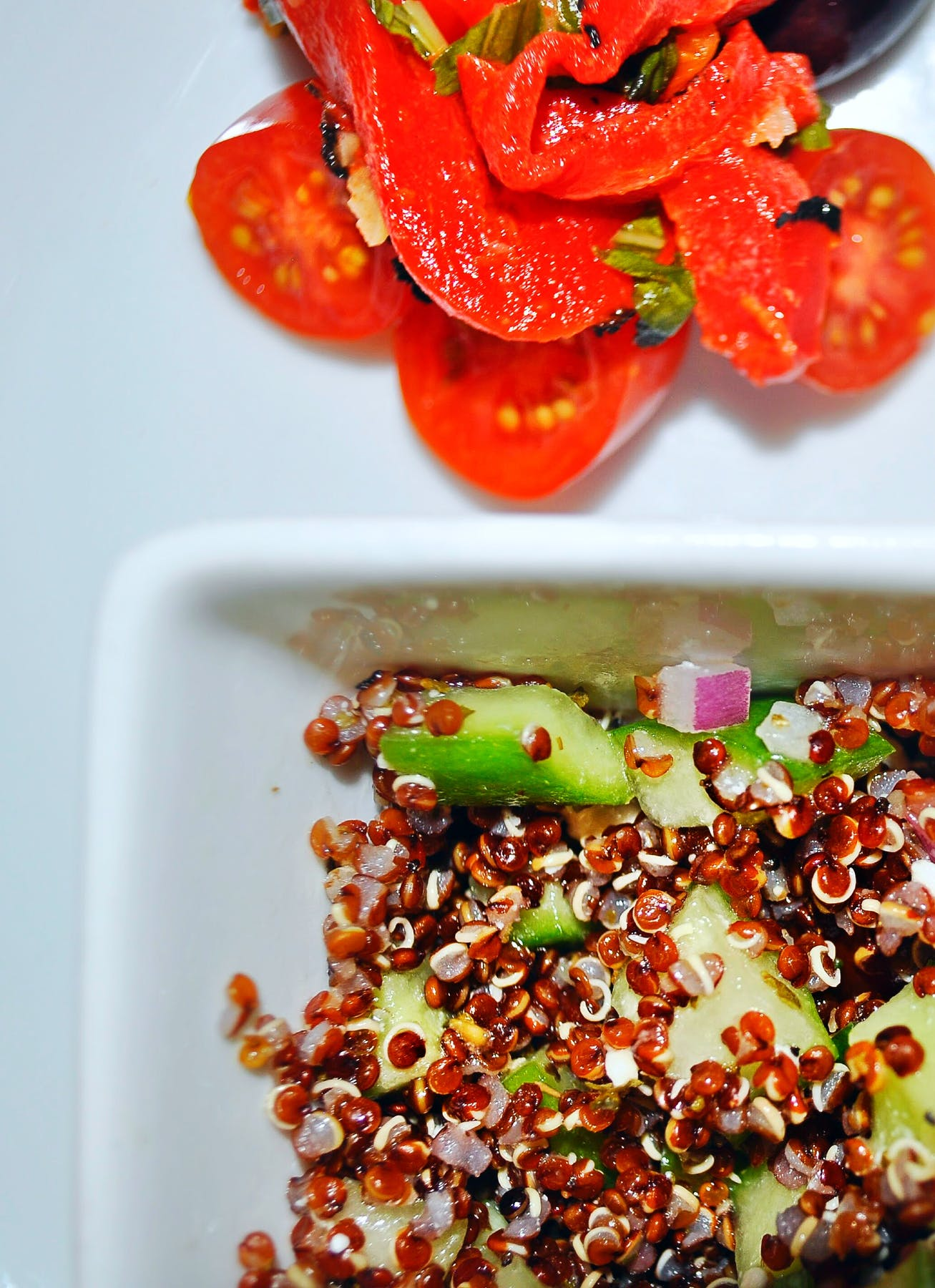 a plate with quinoa salad and vegetables