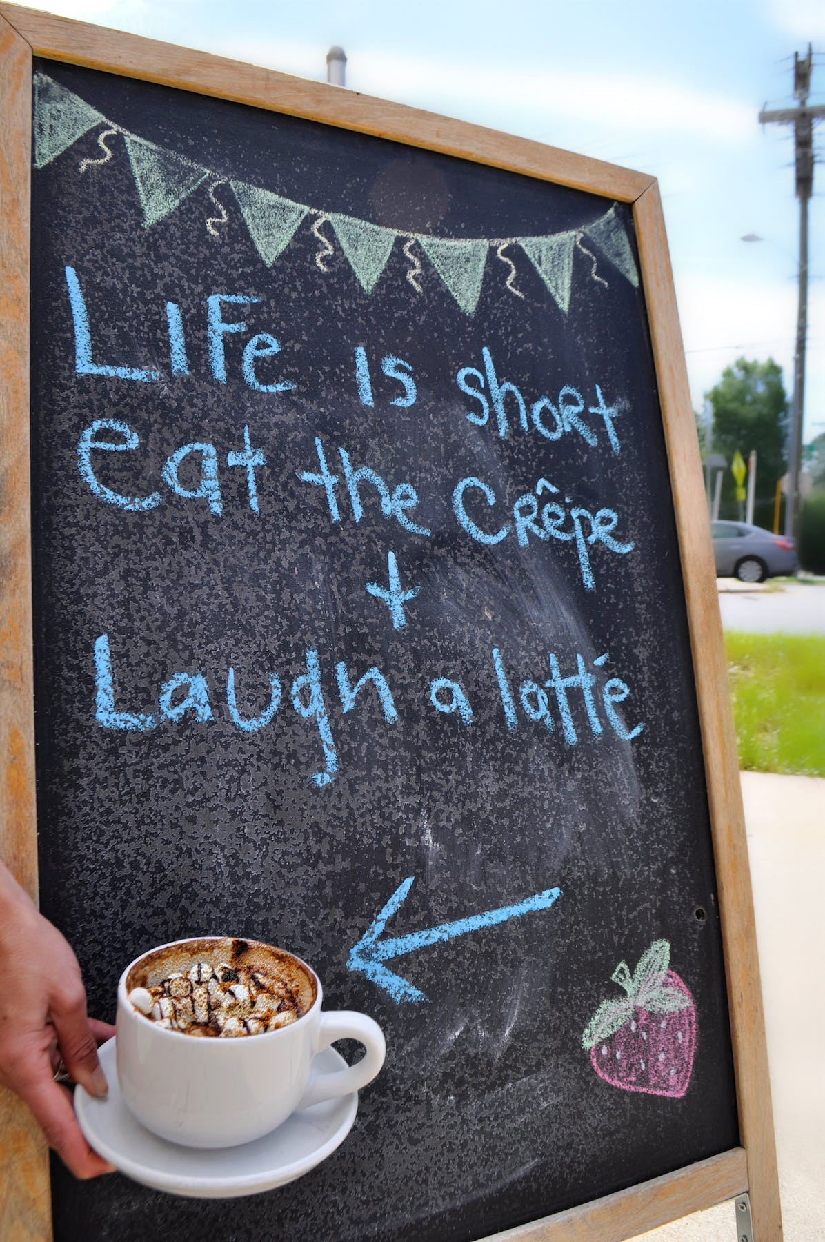 a sign in front of a cake