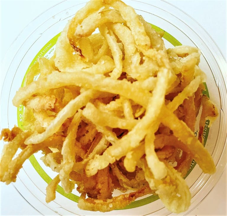 a close up of a plate of fries