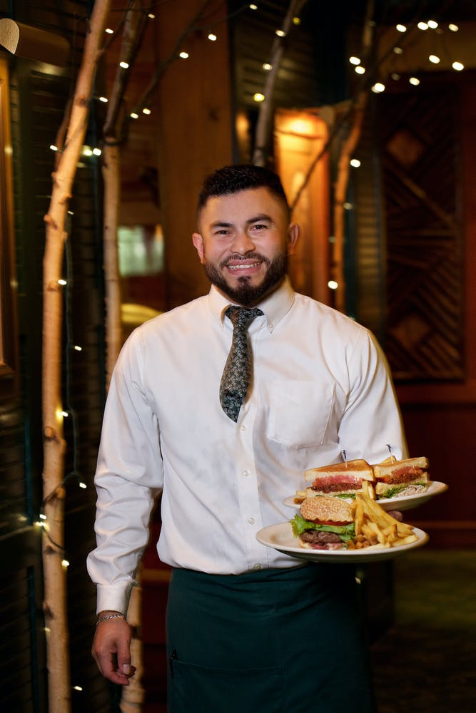 a man standing in front of a plate of food