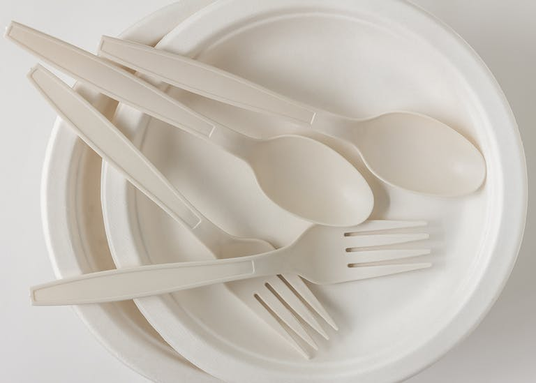 white disposable utensils and plates